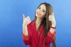 Happy smiling business woman with ok hand sign. On blue backgraund Stock Photo