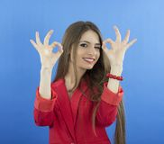 Happy smiling business woman with ok hand sign. On blue backgraund Royalty Free Stock Photo