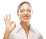 Happy smiling business woman with okay gesture Royalty Free Stock Images