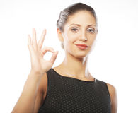 Happy smiling business woman with okay gesture Stock Image