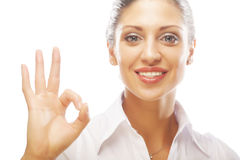 Happy smiling business woman with okay gesture Royalty Free Stock Photos