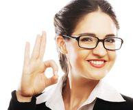Happy smiling business woman with okay gesture Stock Images