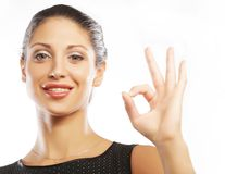 Happy smiling business woman with okay gesture Stock Photos