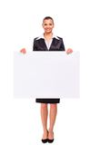 Happy smiling business woman showing blank Royalty Free Stock Photos
