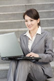 Happy smiling business woman using laptop Stock Images