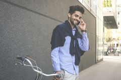 Happy smiling businessman on bike in street having conversation royalty free stock photos