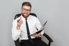 Happy smiling businessman in eyeglasses holding folder Royalty Free Stock Photo