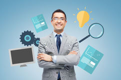 Happy smiling businessman in eyeglasses and suit Royalty Free Stock Photography