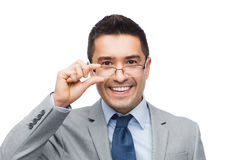Happy smiling businessman in eyeglasses and suit Stock Images
