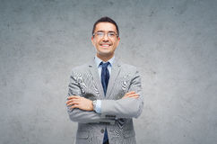 Happy smiling businessman in eyeglasses and suit Stock Photos