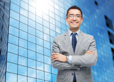Happy smiling businessman in eyeglasses and suit Stock Photography