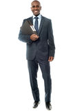 Happy smiling businessman with folder Stock Image