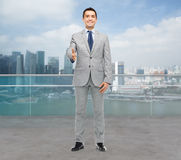 Happy smiling businessman in suit shaking hand Stock Image