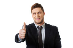 Happy smiling businessman with thumbs up. Royalty Free Stock Images