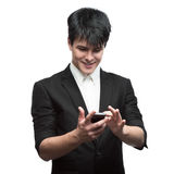 Happy smiling businessman using cell phone Stock Image