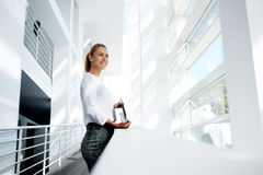 Happy smiling businesswoman thinking about something  Royalty Free Stock Photo