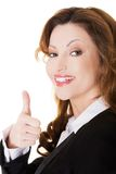 Happy smiling businesswoman with thumb up gesture Royalty Free Stock Image