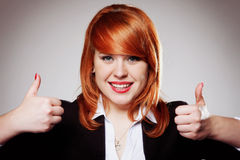 Smiling businesswoman with thumbs up gesture Royalty Free Stock Image