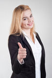 Happy smiling businesswoman with thumbs up gesture Stock Images