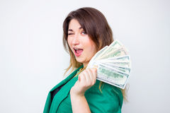 Happy smiling businesswoman wearing in green jacket with money . Closeup portrait super happy excited successful young business wo Stock Images