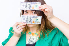 Happy smiling businesswoman wearing in green jacket with money. Woman holding money. Concept of money Stock Photos