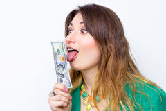 Happy smiling businesswoman wearing in green jacket with money. Woman holding money. Concept of money Stock Photography