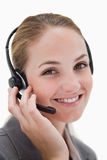 Happy smiling call center agent at work Royalty Free Stock Image