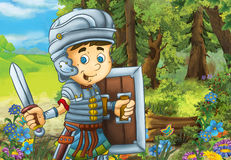 Happy smiling cartoon roman soldier standing with sword and shield in the forest Royalty Free Stock Image