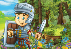 Happy smiling cartoon roman soldier standing with sword and shield in the forest Stock Photo