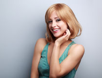 Happy smiling casual blond woman with short hair. On blue background with empty copy space Royalty Free Stock Photography