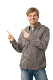 Happy smiling casual man pointing cutout royalty free stock photo