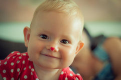 A happy smiling caucasian baby in red Royalty Free Stock Photo