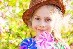 Happy smiling caucasian blond child girl in the garden. Portrait of happy smiling five years old caucasian blond child girl in a hat on blooming garden Stock Photos