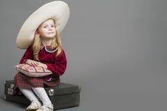 Happy And Smiling Caucasian Child Posing in Big Round Sombrero H Stock Photo