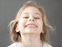 Happy smiling caucasian five years old blond child girl stock photo