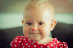 A happy smiling caucasian heart nose baby stock photo