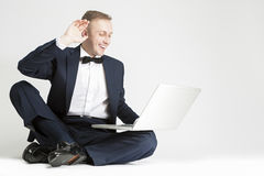 Happy Smiling Caucasian Man in Blue Suit with Laptop Chatting Stock Photos
