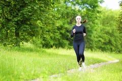Happy Smiling Caucasian Sportwoman Having Her Regular Training O Royalty Free Stock Photo