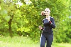 Happy Smiling Caucasian Sportwoman Having Her Regular Training  Stock Photography