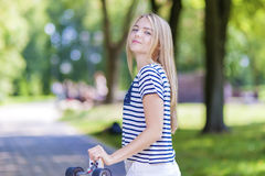 Happy Smiling Caucasian Teenage Girl Posing With Long Skateboard Outdoors. Stock Photos