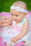 Happy smiling cheerful baby girl in pink hood with ears Royalty Free Stock Images