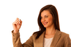 Happy smiling cheerful beautiful young business woman writing or Stock Images