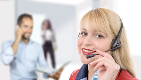 Happy smiling cheerful support phone operator in headset stock photo