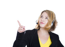 Happy smiling cheerful young woman customer support phone operator or sales representative in headset pointing at something Stock Photos
