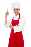 Happy smiling chef showing index finger Stock Photography