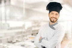 Happy smiling chef standing in kitchen stock images