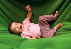 Happy smiling child on blanket Stock Image