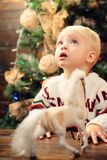 Happy smiling child boy with christmas gift box. Child new year. Kids christmas. New Year`s Eve. Winter evening at home. royalty free stock photography