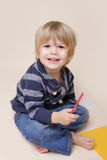Happy Smiling Child doing Arts, with Crayon Stock Photos
