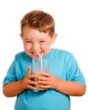 Happy smiling child drinking chocolate milk. Isolated on white Stock Image